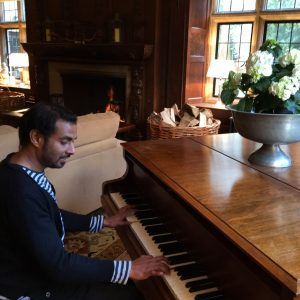 Playing piano at a student home.